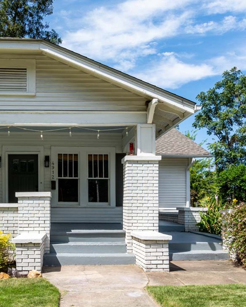 Exterior of home for sale by an abundant real estate agent