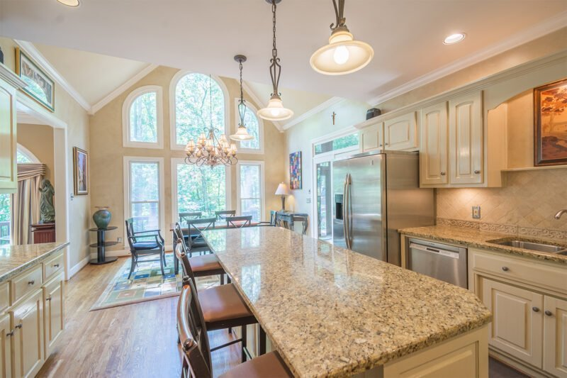 Large kitchen at a Greystone home in Birmingham AL by real estate photographer Aly Hathcock