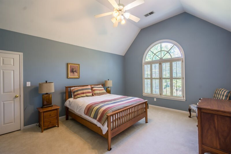 Blue guest bedroom in luxury home in Greystone in Birmingham, Alabama